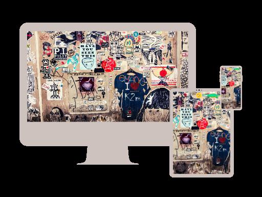 PC Tablet und Mobile mit Bild: Wand mit verschiedenen Kritzeleien
